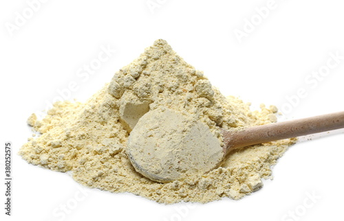 Fotografía Chickpea flour pile with wooden spoon isolated on white background