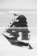 Black And White Pirate Ship Against The Sea And Crushing Waves. Double Exposure