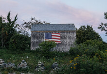Old Rustic Shed With American Flag
