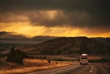 Semi-truck Driving In Beautiful Mountain Scene