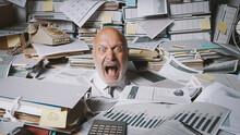 Stressed Businessman Buried Un...