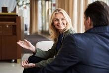 Joyful Woman Gesturing While Talking To Man Next To Her