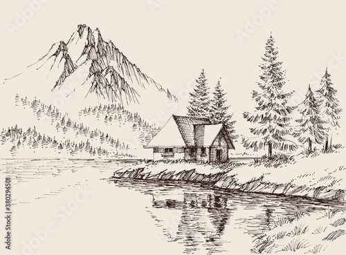 A house by the lake in a beautiful relaxing mountains landscape Canvas-taulu