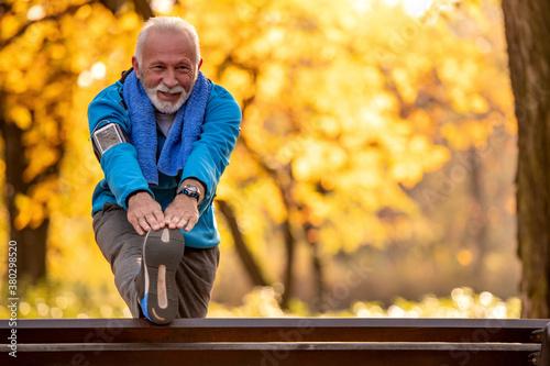 Senior man stretching outdoors.