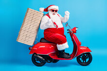 X-mas Christmas Tradition Win Full Length Profile Side Photo Of White Grey Bearded Hair Santa Claus Drive Scooter Deliver Pizza Raise Fists Wear Red Costume Isolated Blue Color Background