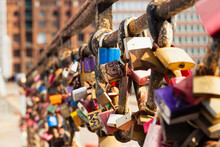 Colored Love Locks On A Bridge In Hamburg, Photographed Up Close.
