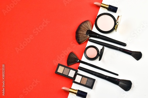 Fotografie, Obraz Professional cosmetics and makeup brushes on a red-white background