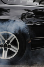 Car In Motion With Smoke Coming From The Tires