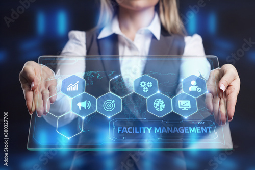 Fototapeta Business, Technology, Internet and network concept. Young businessman shows the word on the virtual display of the future: Facility management obraz