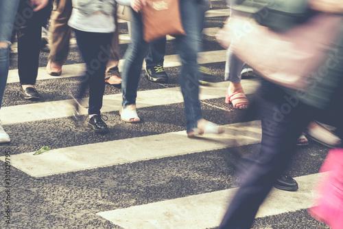 Fototapeta Unrecognizable blurred people walking around the city obraz