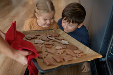 Children Smelling Freshly Baked Gingerbread Cookies