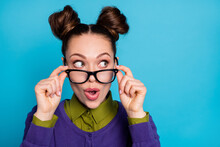 Closeup Photo Of Attractive Lady Two Funny Buns Good Mood Take Off Vision Eyesight Specs Interested Look Side Empty Space Wear Shirt Collar Violet Sweater Isolated Blue Color Background