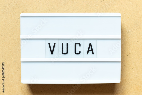 Lightbox with word VUCA (abbreviation of Volatility, uncertainty, complexity and Wallpaper Mural