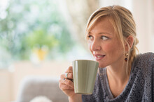 Pensive Woman Drinking Coffee
