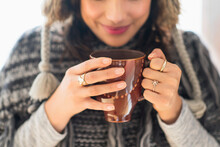 Young Woman Holding Mug With H...
