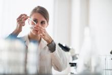 Female Lab Technician Using Pi...