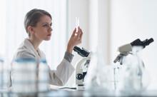 Female Lab Technician Examinin...