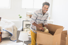 Man Packing Decors Into Cardbo...