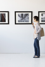 Woman Watching Photographs In ...