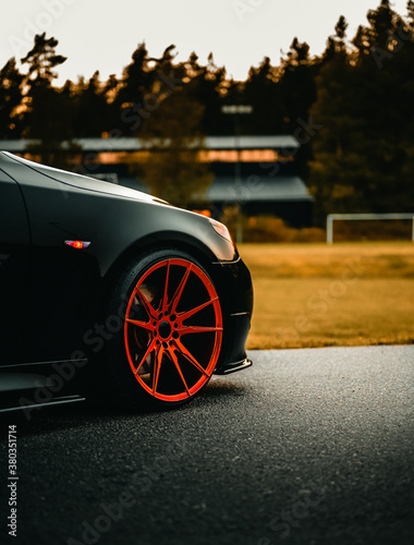 Fototapeta Front wheel shot of a black german car obraz