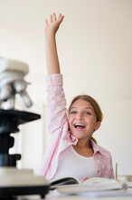 Girl (12-13) Raising Hand To A...