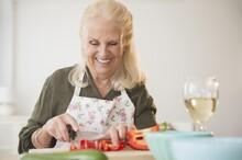 Senior Woman Cutting Pepper