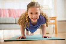 Girl (10-11) Exercising Yoga