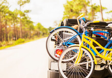 Couple In Car With Bike Rack
