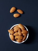 Stack Of Almonds In Ramekin