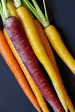 Colorful Carrots On Black Back...