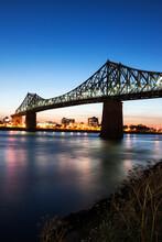 Illuminated Jacques Cartier Bridge Against Sky