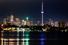 Illuminated Waterfront Skyline...