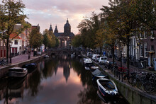 Water Canal In City At Sunrise