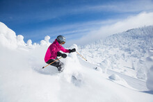 Woman Skiing In Mountains