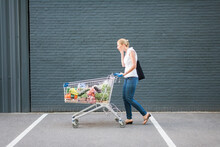Woman Walking With Shopping Cart