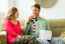 Man Holding Unwanted Christmas Gift