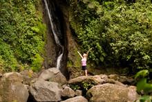 Woman Under Waterfall