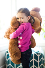 Portrait Of Girl (4-5) Hugging Teddy Bear