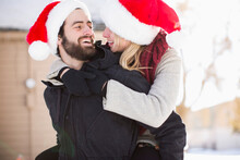 Young Couple In Santa Hats, Pi...