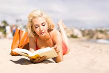 Portrait Of Blond Woman Readin...