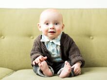 Baby Boy (6-11 Months) Sitting On Sofa