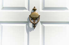 Close-up Of White Door With Knocker