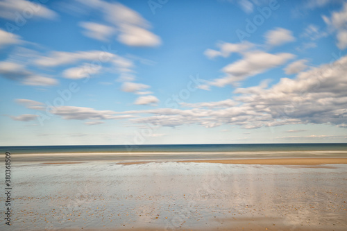 Sandy beach in water, horizon over sea - 380368509