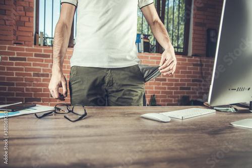 businessman showing his empty pocket