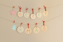 Merry Xmas Spelled Out On Handmade Banner
