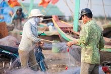 Fishermen Repairing Nets On A Boat Trip Out To Sea In The Afternoon July 31, 2016 At The Beach Of Hai Ly, Vietnam.