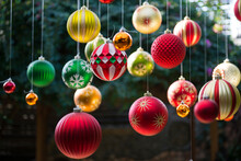 Many Colorful Christmas Balls Hanging In The Garden With Sunlight