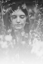 Black And White Ethereal Portrait Of Woman With Eyes Closed Amongst Wildflowers In Bloom