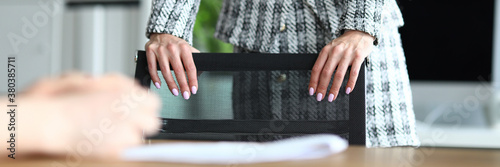 Fototapeta Close-up of businesswoman with nice manicure. Lady touching chair. Office worker in modern cabinet. Young woman in luxury suit. Business and presentable look concept obraz