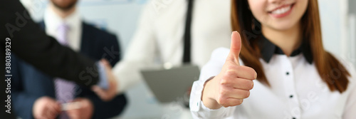 Fototapeta Woman showing confirm symbol during conference in office as high level and quality of product or mediation gratitude concept obraz